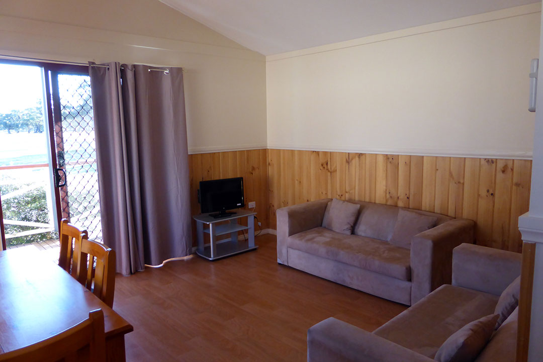 Lounge area of self-contained cabin accommodation at Darlington Point Club
